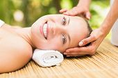 foto of day care center  - Close up of an attractive young woman receiving facial massage at spa center - JPG