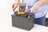 picture of  multimeter  - Testing car battery with digital multimeter - JPG