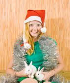 stock photo of tawdry  - teen girl in peddlery with two pet rabbits - JPG