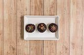 image of cake-ball  - Fresh chocolate ball cakes sprinkled with colorful sugar balls - JPG
