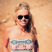 foto of hippy  - Pretty young hippie caucasian girl enjoys good weather and the hot sun on a beach - JPG