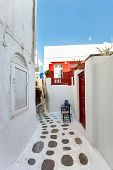 foto of greek-island  - Typical greek traditional village with white walls and colorful doors - JPG