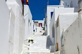 picture of greek-island  - Typical greek traditional village with white walls and colorful doors - JPG