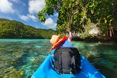 stock photo of kayak  - Little girl kayaking with her father in ocean among tropical islands during summer vacation - JPG