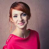 image of young woman posing the camera  - Beautiful young fashionable woman posing in red dress smiling looking at camera - JPG