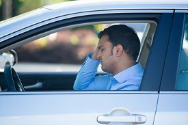 image of pissed off  - Closeup portrait angry young sitting man pissed off by drivers in front of him hand on head - JPG
