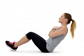picture of abdominal  - Girl exercising workout fitness aerobic exercise abdominal push ups posture on studio isolated - JPG