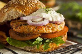 stock photo of burger  - Homemade Organic Salmon Burger with Tartar Sauce - JPG