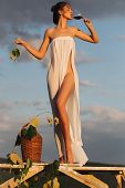 Pretty Girl With Wine Bottle Over Sky poster