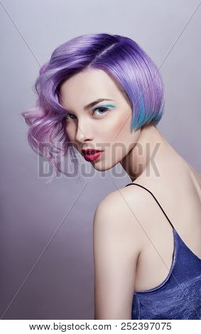 poster of Portrait Of A Woman With Bright Colored Flying Hair, All Shades Of Purple. Hair Coloring, Beautiful