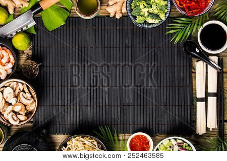 Asian cuisine ingredients on bamboo