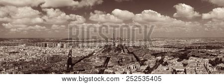 poster of Paris rooftop view panorama with Eiffel Tower and city skyline.