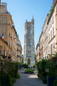 Paris Typical Street And Saint-jacques Flamboyant Gothic Tower Remains Of A Church In Paris France poster