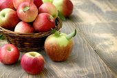 Delicious Apple - Juicy Red Apples In Wicker Basket On Table poster