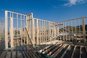 stock photo of inference  - Image shows a home under construction at the roofing phase - JPG