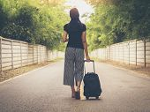 Traveling Girls Are Traveling With Luggage. Through Nature Tourism. (travel Ideas) poster