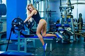 Brutal Fitness Sexy Woman With A Muscular In The Gym. Sports And Fitness - Concept Of Healthy Lifest poster