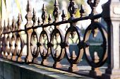 image of wrought iron  - Detail of Wrought Iron work around Grave Headstone - JPG