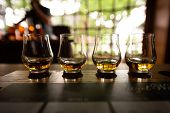 Bourbon Flight With Selective Focus On Four Samples poster