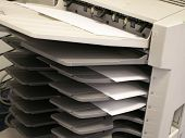 image of collate  - a copy machine with copies in tray - JPG