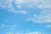 Rain Drops, Water Drops Of Rain On A Window Glass. Blurred Lights City With Sky Clouds In Rainy Day, poster
