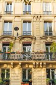 Old Paris Residential Buildings With Balconies And Flowers. Beautiful Facade Of Typical French City poster