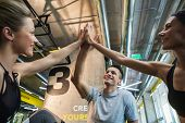 Happy Team Are Clapping Hands With Joy In Studio poster