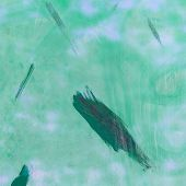 Light Green Painted Surface With Smears Of Dark Green Paint On Top Of It. Abstract Background Of Old poster