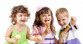 image of ice cream cone  - happy children group with ice cream in studio isolated - JPG