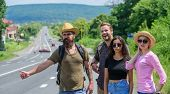 Friends Hitchhikers Travelling Summer Sunny Day. Begin Great Adventure In Your Life With Hitchhiking poster