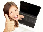 stock photo of cheer up  - Laptop woman happy giving thumbs up success sign sitting at computer PC with excited face expression - JPG