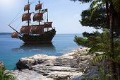 Vintage Pirate Ship To Go Anchor In A Natural Caribbean Harbor To Seek Refuge From British Warships, poster