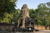 Ancient Ruins Of Ta Prohm Temple In Angkor Wat Complex, Cambodia. Tower With Buddha Face. Stone Temp poster