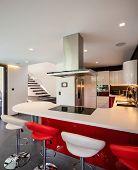 Red kitchen detail in modern villa. Nobody inside poster