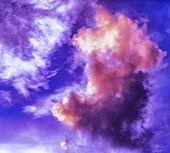 A Stunning Vibrant Sky Cloudscape Scene, With Orange, Purple And White Coloured Cumulonimbus Cloud F poster