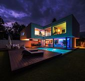 Modern villa with colored led lights at night. Nobody inside poster