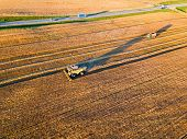 High Angle Shot Of The Harvesters Working In The Field poster