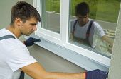 Man Worker In Protective Gloves Measuring External Frame And Pvc Window Metal Sill Size. Builder Che poster