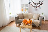holidays, decoration and party concept - home room with jack-o-lantern or carved pumpkin, halloween  poster