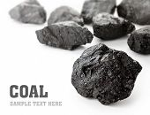 image of briquette  - Coal lumps spilled on white background with copy space - JPG