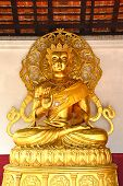 Golden Buddha image in church of Buddhist temple in Thailand