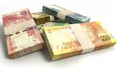 stock photo of nelson mandela  - A scattered pile of bundled south african rand bank notes on an isolated background - JPG