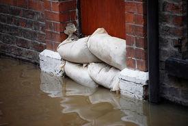 picture of safety barrier  - Sandbag barrier in doorway of flooded street in York - JPG