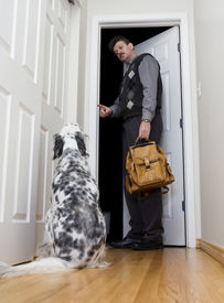 image of dog-house  - A man leaving for work asks his dog to behave and watch the house - JPG