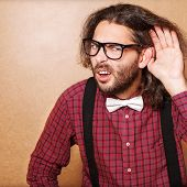 pic of shock awe  - Emotional portrait of a guy who is trying to hear each other hipster Style studio shot - JPG