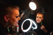 pic of drag-queen  - Caucasian drag queen at mirror in dressing room - JPG