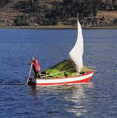 Peruvian man sails by boat.