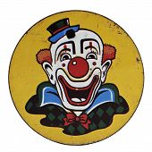 pic of clown face  - Vintage Tin Clown Printed Round Noisemaker over white - JPG