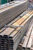 picture of ferrous metal  - Rectangular metal pipe for construction on site - JPG
