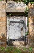 picture of english ivy  - Old doorway to Cotswold manor house garden - JPG